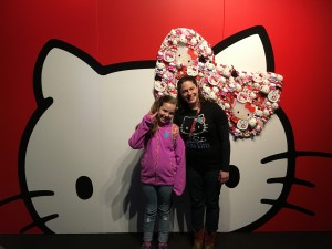 Rachael and Gigi pose in front of a giant Hello Kitty head at the EMP exhibit.
